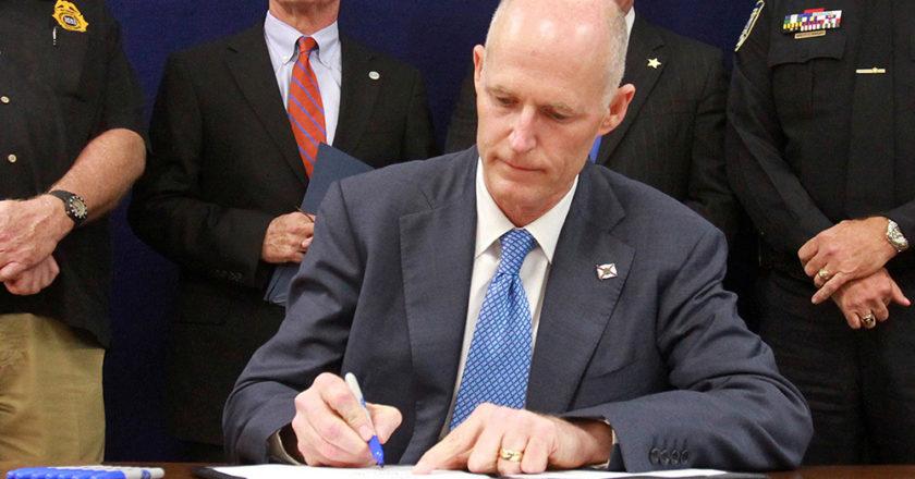 Rick Scott Signing